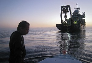 "Peter Leonard, chief mate on the research vessel Atlantis, aided in a late-day recovery of the submersible Alvin during one of 14 certification dives in November near the coast of Southern California. Leonard is among qualified ""swimmers"" who assist with the launch and recovery of Alvin, which is back in the water after a three-year major overhaul and upgrade. During the dives, the Alvin operations team, along with observers from the U.S. Navy, took the submersible to progressively greater depths to prove that all of its systems are safe for operation. Alvin will return to full service to marine science this spring. (Photo by Rod Catanach, Woods Hole Oceanographic Institution)"